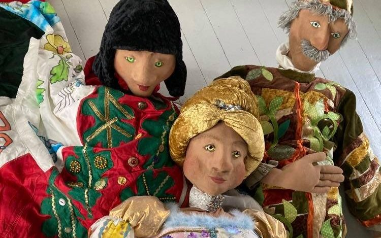 Plush stuffed puppets in elaborate clothing