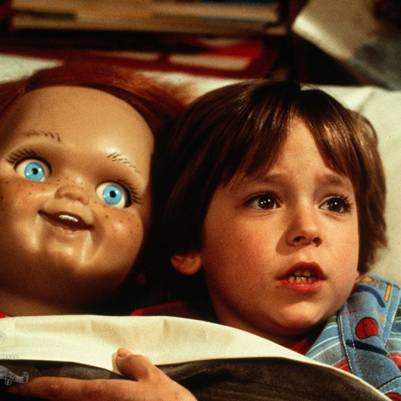 Young boy with a scary doll