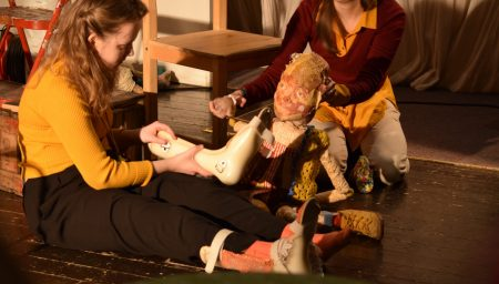 Two puppeteers operating a puppet with Cerebral Palsy