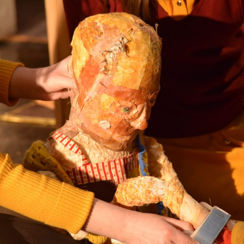 Puppeteer operating a puppet with Cerebral Palsy
